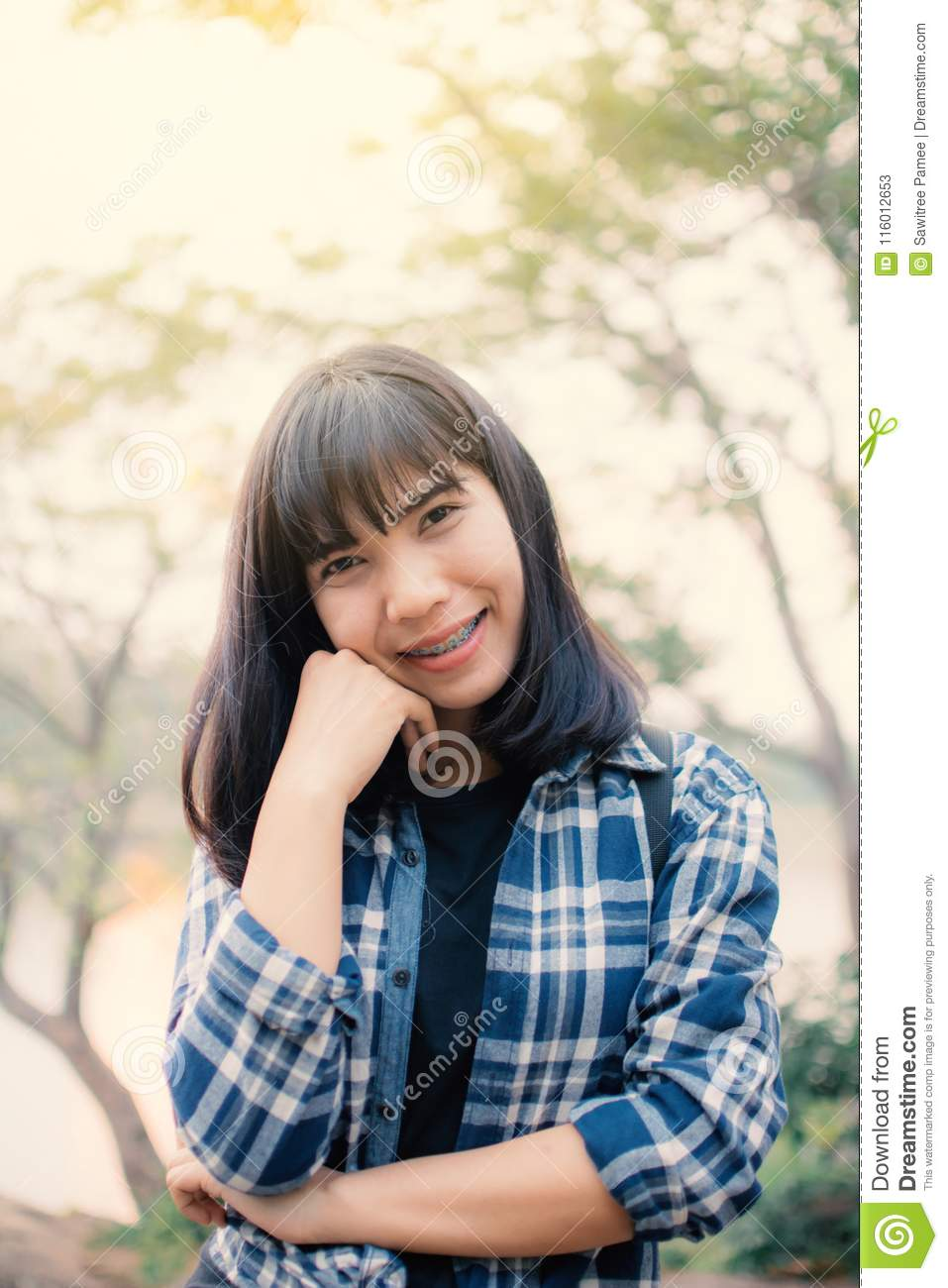 Happy Asian woman relaxing on holiday travel concept