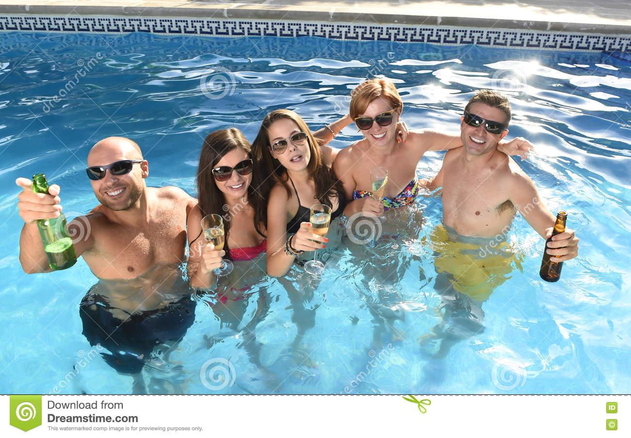 e67ade183d7af Group of friends young happy attractive men and women in bikini having bath  at hotel resort swimming pool drinking beer bottle having fun smiling  playful in ...