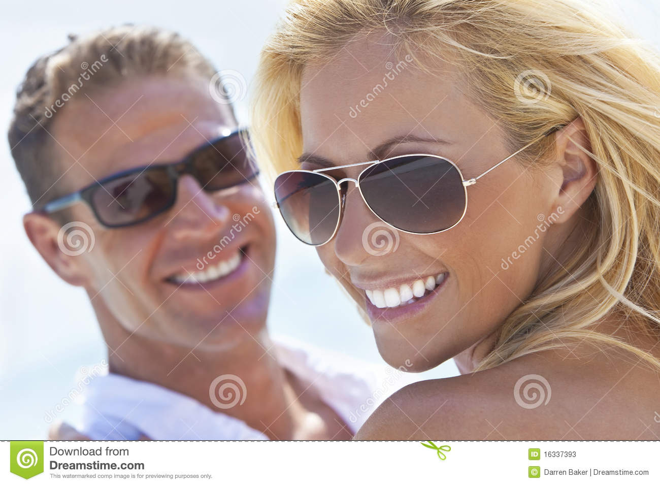 Happy Attractive Woman and Man Couple At Beach