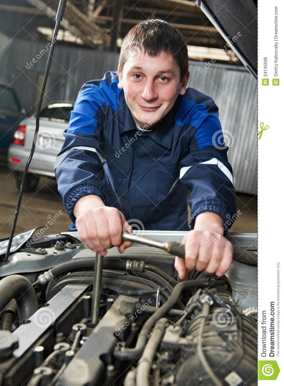 Happy Automotive Mechanic At Work With Wrench Royalty Free