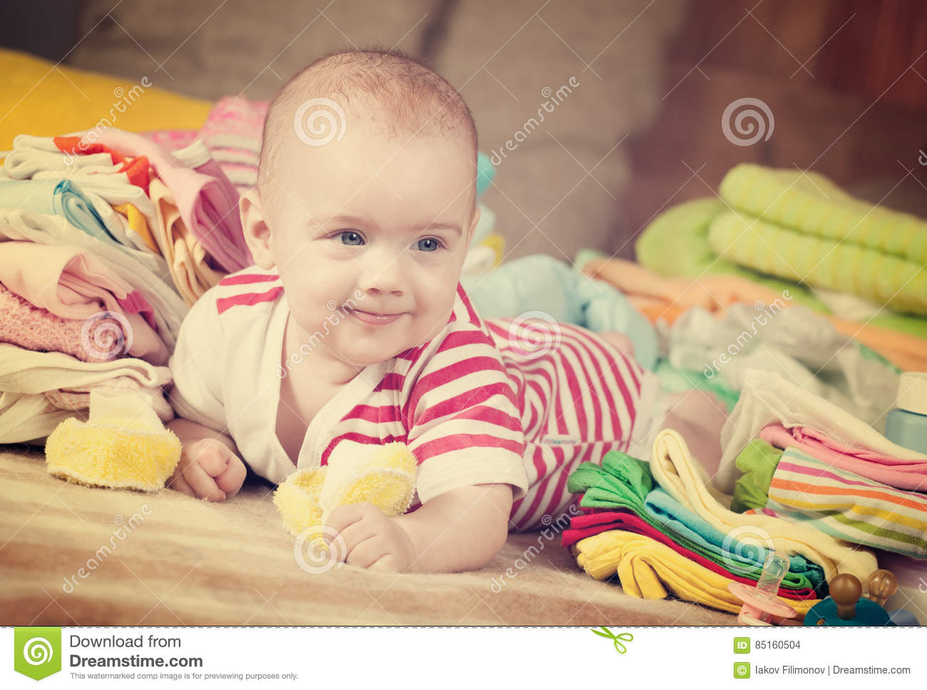 Happy baby with baby`s wear