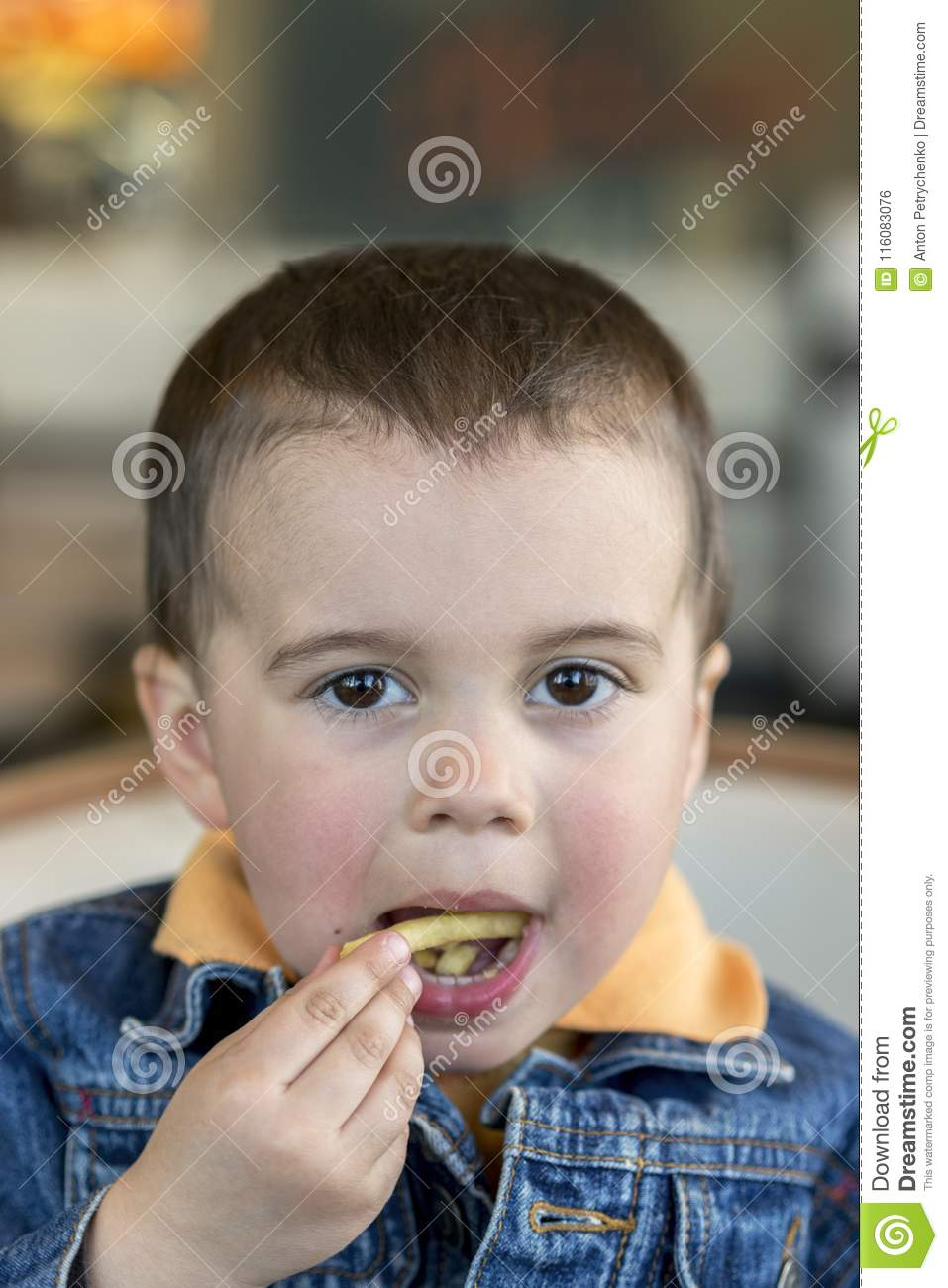 1ce34b0317eb2 A happy baby boy eats French fries. fast food. European. boy 2 years old  close-up eating french fries. Cute little baby boy sitting at cafe eating  tasty ...