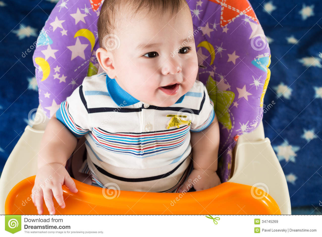 Download Happy Baby Boy Is Sitting At The Childrens Table Stock Image - Image of looking, male: 34745269