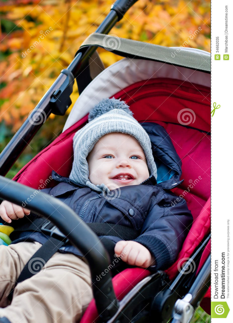 Happy Baby Boy Sitting In A Stroller Royalty Free Stock Photo ...