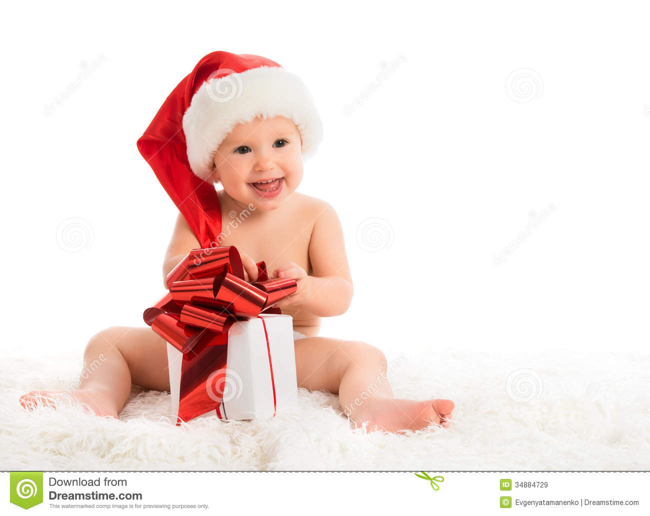 Happy Baby In A Christmas Hat With A Gift Isolated Stock