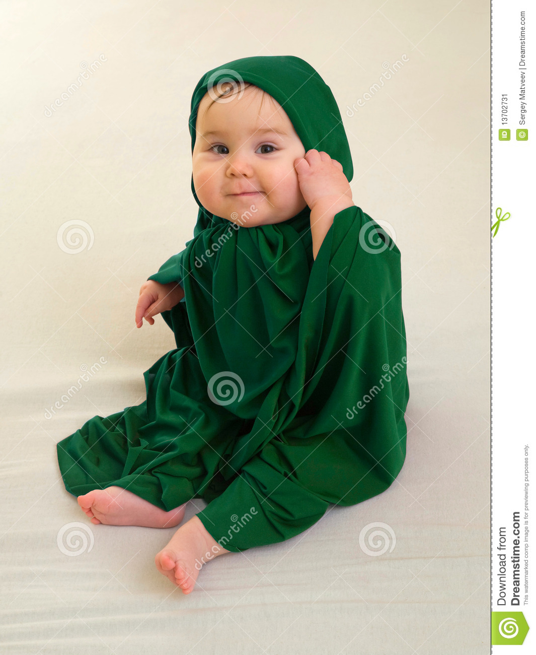 2ea59adc7b99 Happy Baby Girl In Green Muslim Dress Stock Image - Image of ...