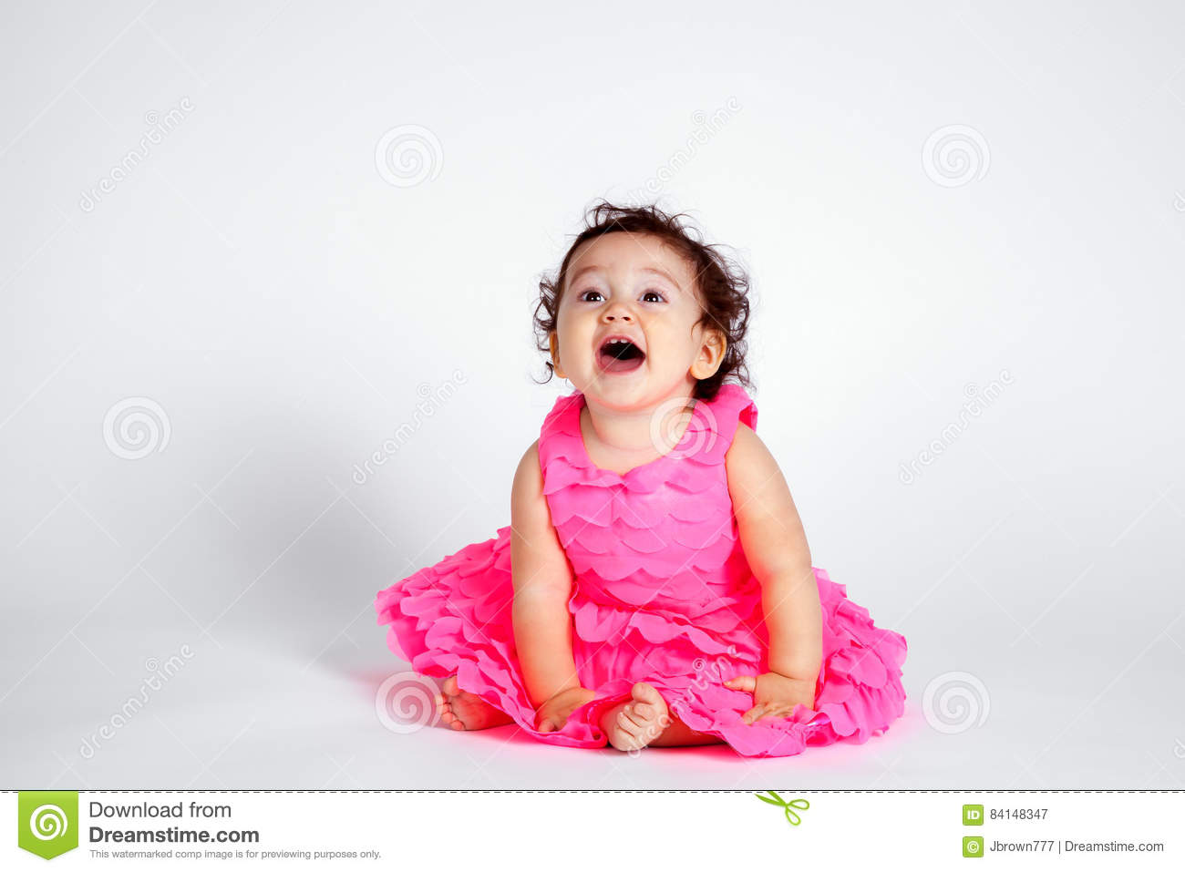 Happy Baby Girl In Pink On White Background Stock Image