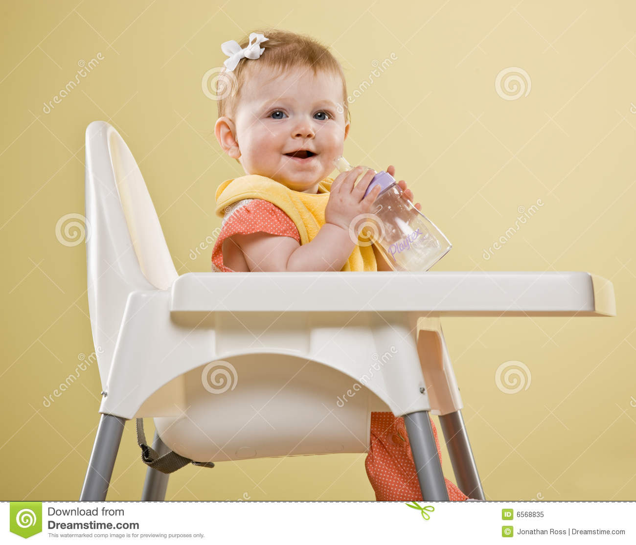 Happy baby girl sitting in highchair stock image image for Toddler sitting chair
