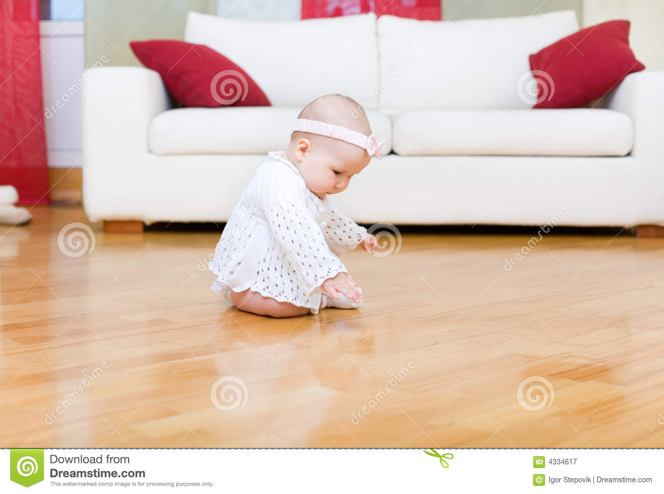 Happy baby girl touch a floor royalty free stock for Hardwood floors and babies