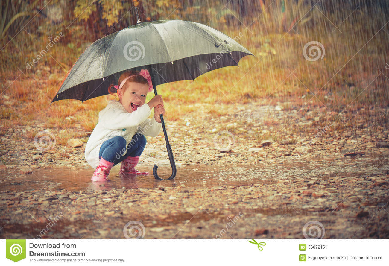 3cca0b453194 Happy Baby Girl With An Umbrella In The Rain Playing On Nature Stock ...