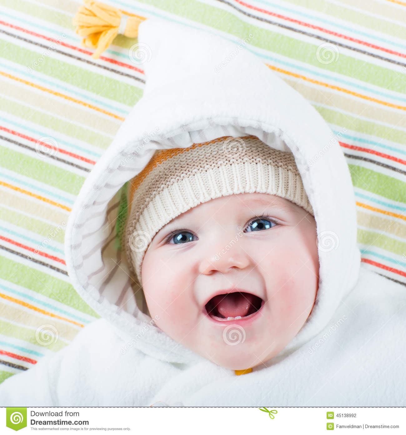 edfbc827e Happy baby in a hat stock photo. Image of blanket