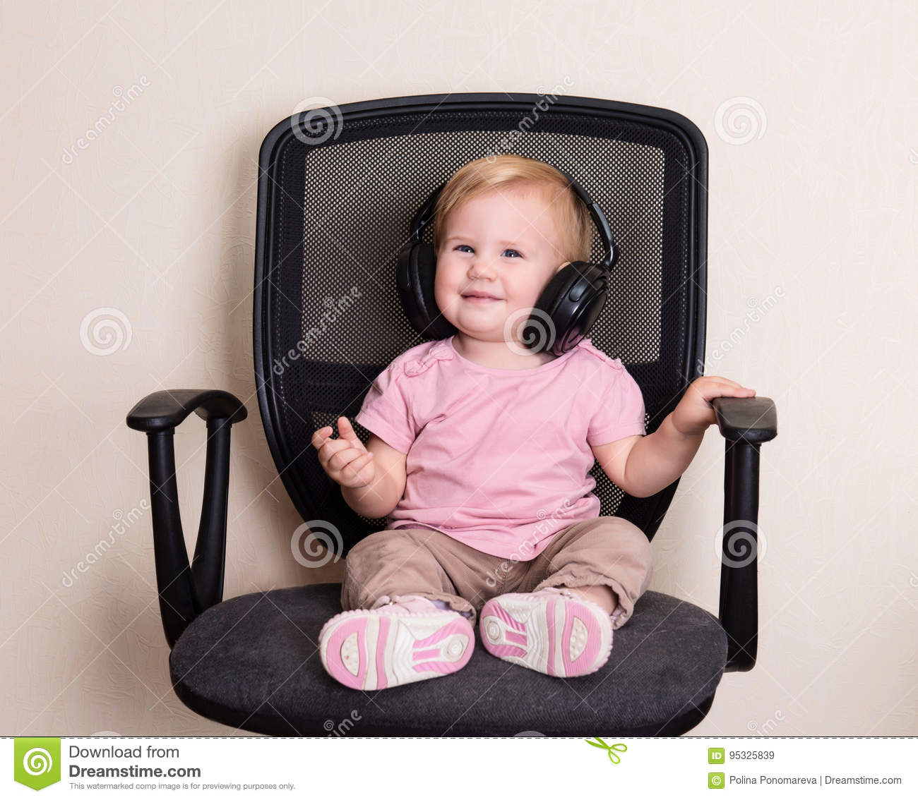 Strange Happy Baby In Office Chair In Headphones Toddler Girl Interior Design Ideas Apansoteloinfo