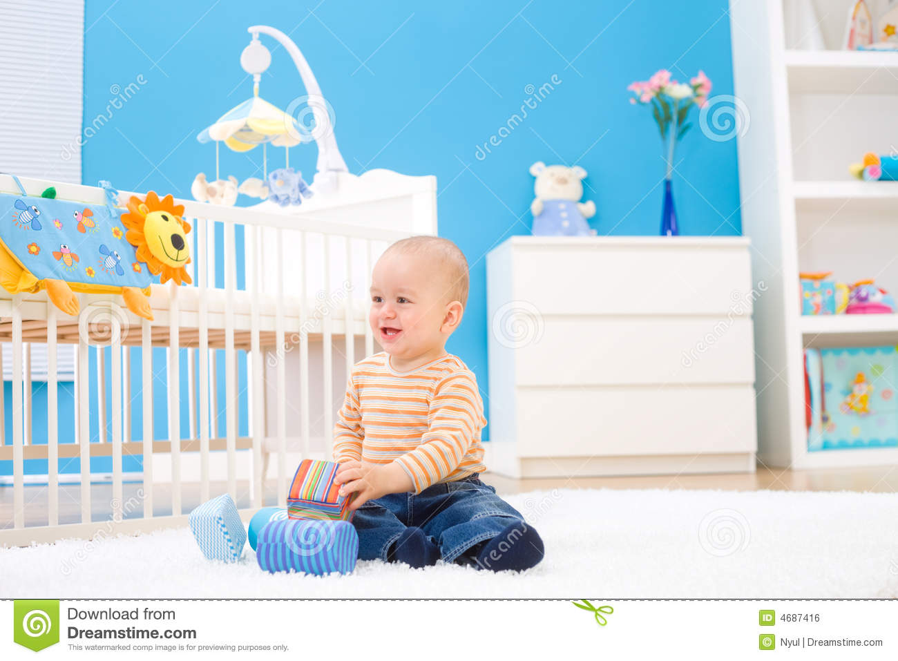 Happy baby playing indoor