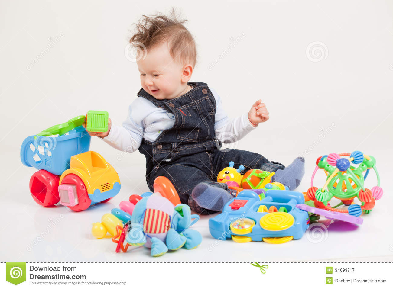 Happy Baby Playing With Toys Royalty Free Stock