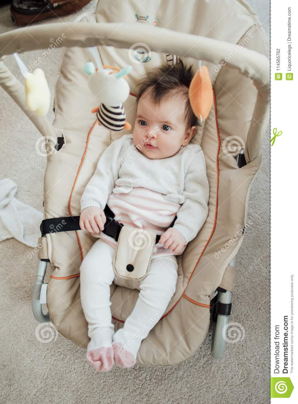 d86995c29 Happy Baby Relaxing In A Bouncer Chair Stock Photo - Image of ...