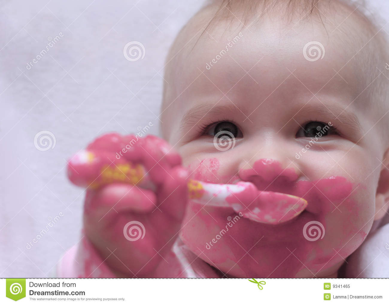 Happy Baby With A Spoon In The Mouth Royalty Free Stock ...