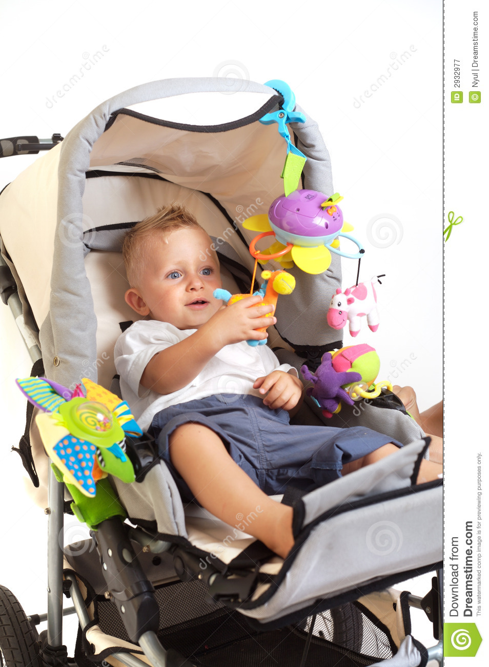 Happy Baby In Stroller Royalty Free Stock Photography - Image: 2932977