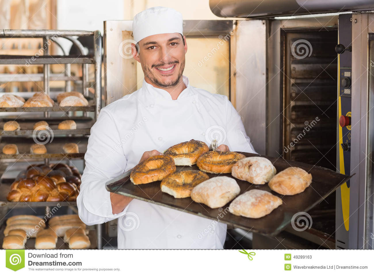 Happy Baker Showing Tray Of Fresh Bread Stock Image