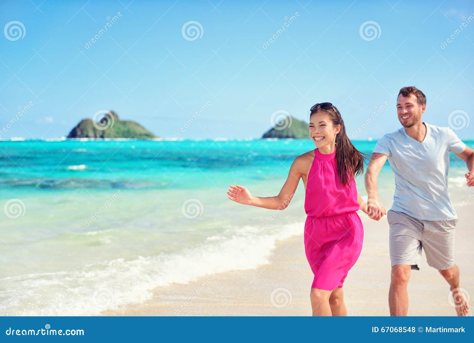 Happy Beach Fun Couple On Summer Vacation Getaway Stock Photo Image 67068548