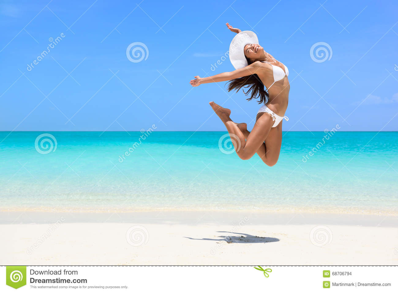 Happy beach woman jumping of weight loss success