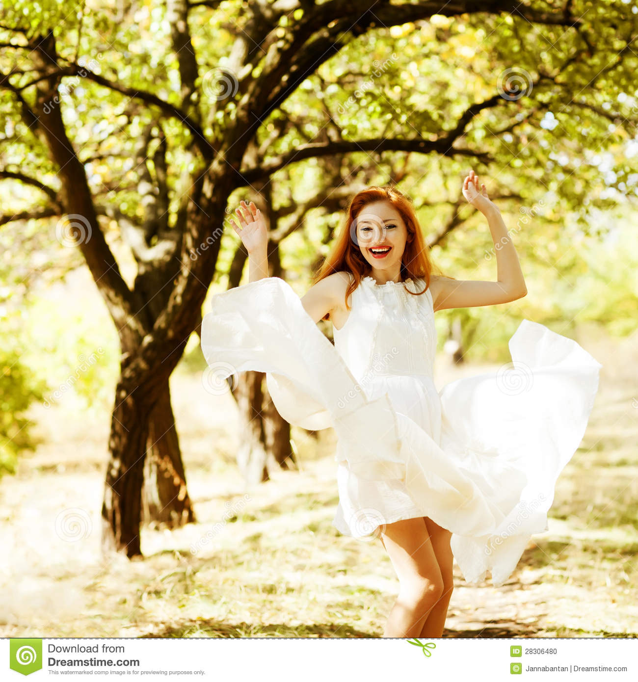 Happy beautiful ginger girl is dancing in a flying white vintage