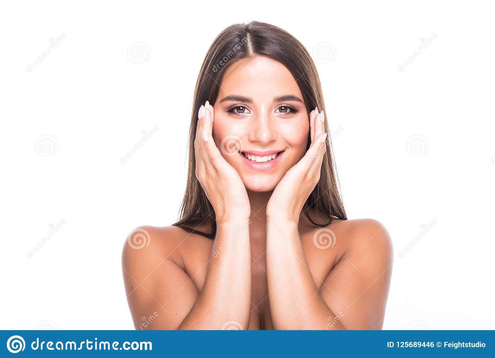Happy beautiful girl holding her cheeks with a laugh looking to the side. Expressive facial expressions. Cosmetology and Spa