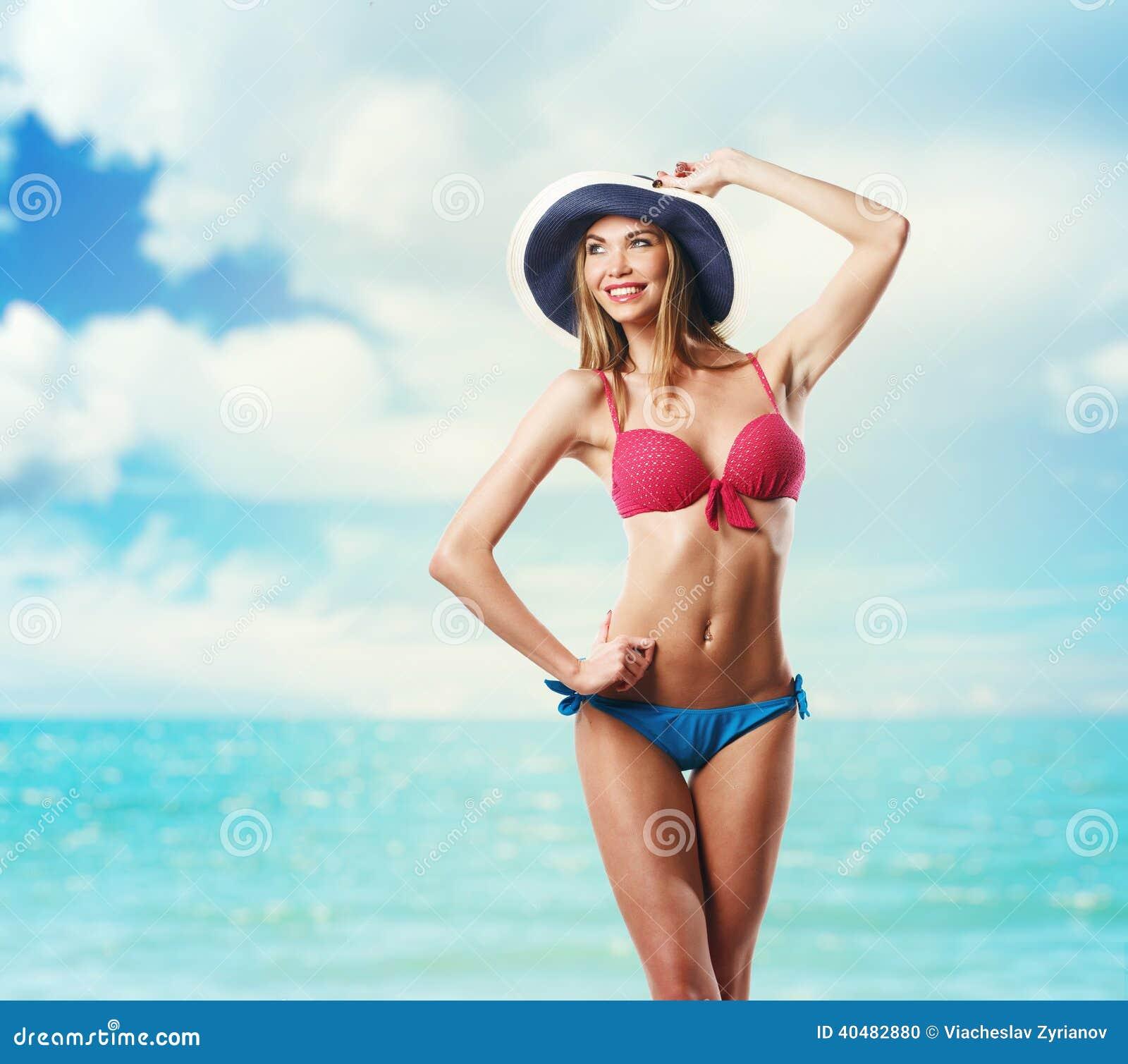 Happy Beautiful Woman In Bikini And Hat On The Beach Stock
