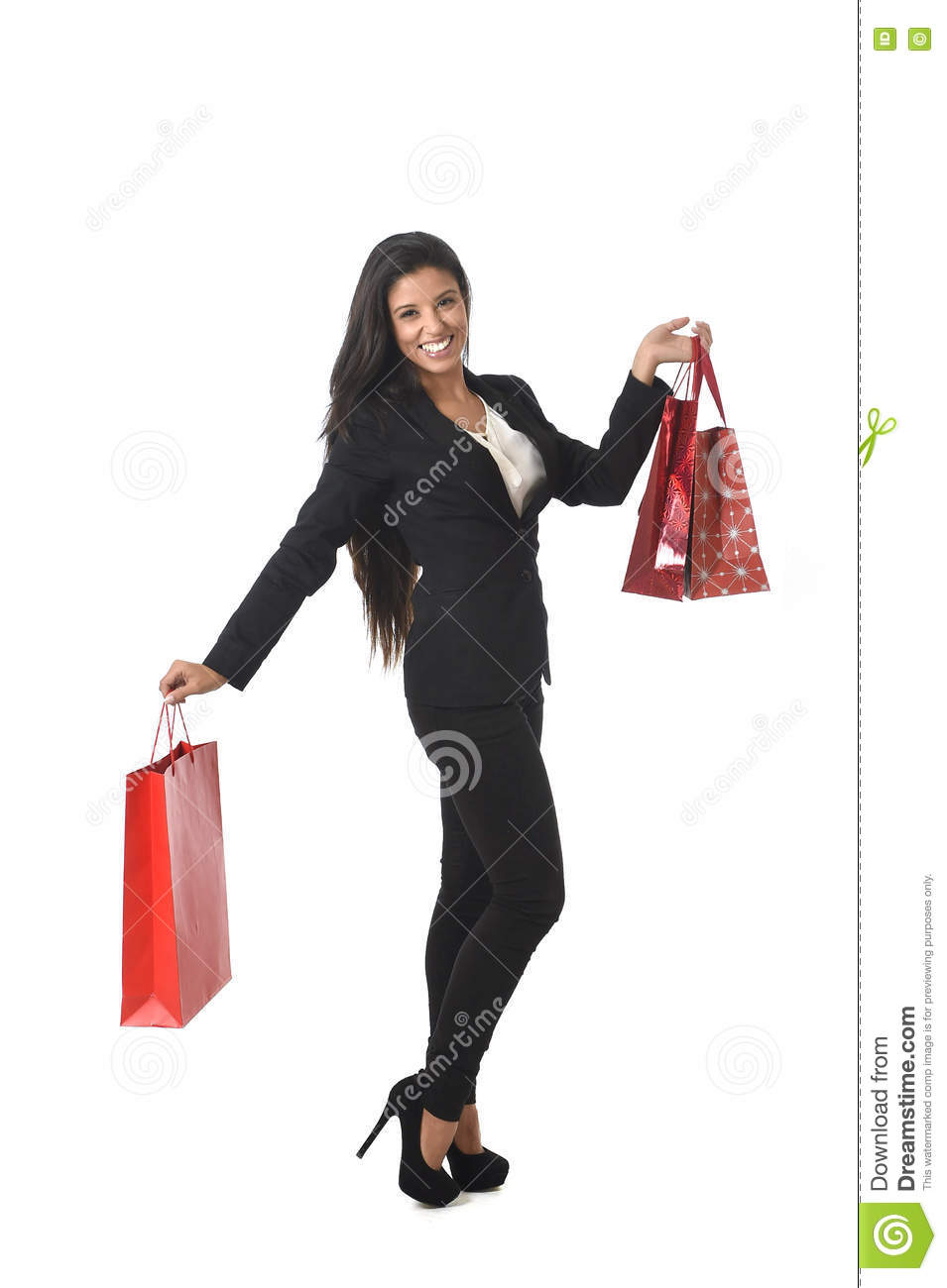 Happy beautiful woman in elegant suit holding sale shopping bags excited cheerful