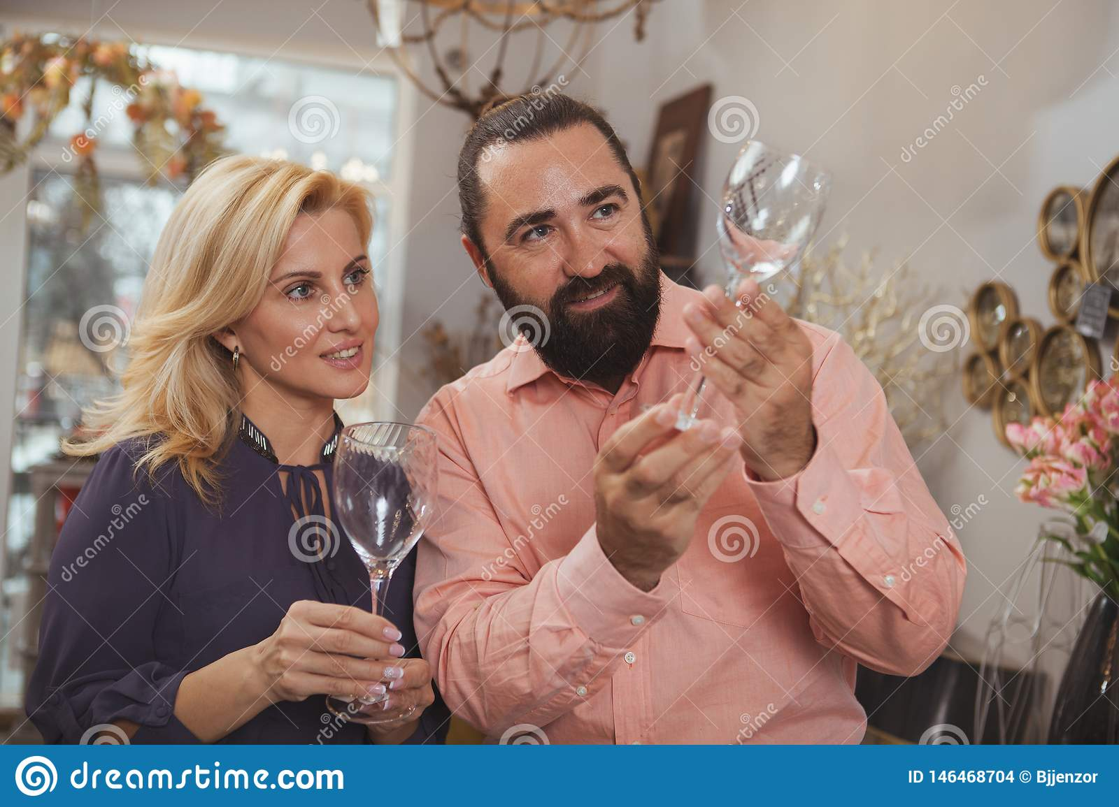 Lovely mature couple buying kitchenware at the store