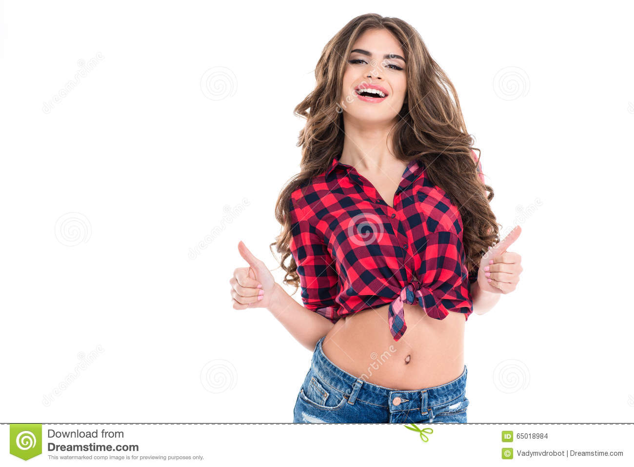Happy beautiful young woman showing thumbs up with both hands