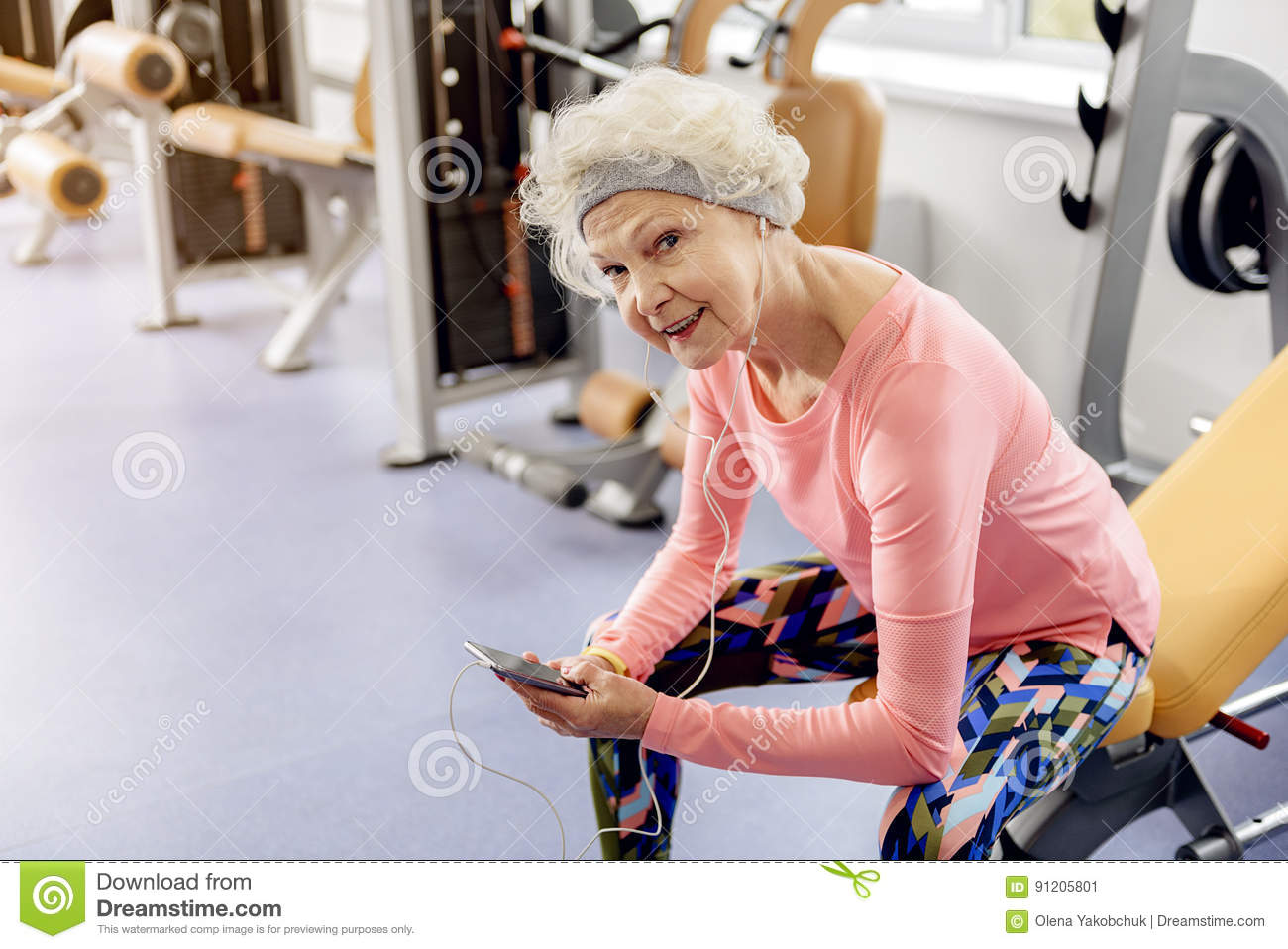 Happy Beneficiary Listening Music In Workout Facility Stock Image
