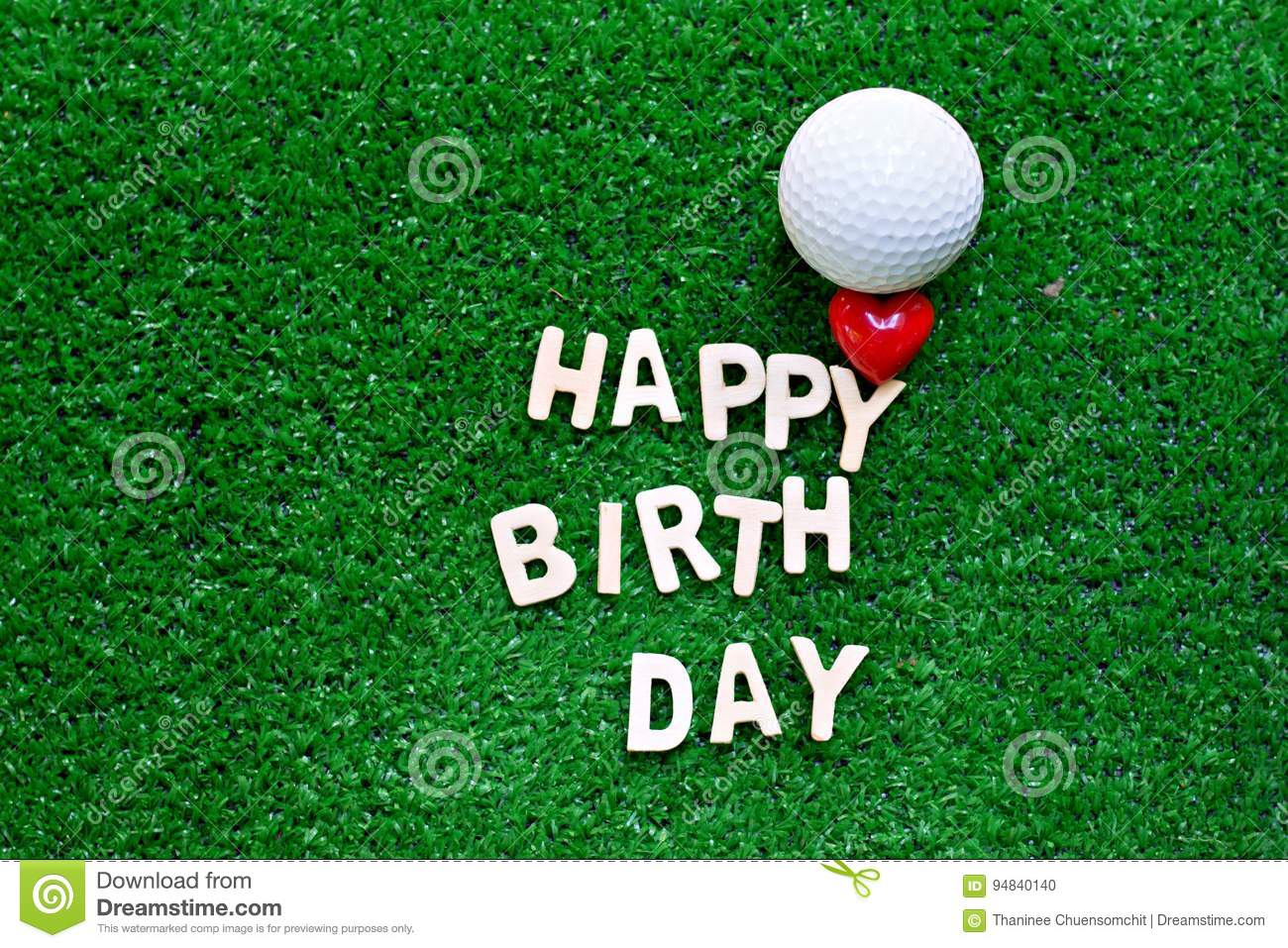 Golf Ball With Happy Birthday Wording On Green Grass For Golfer
