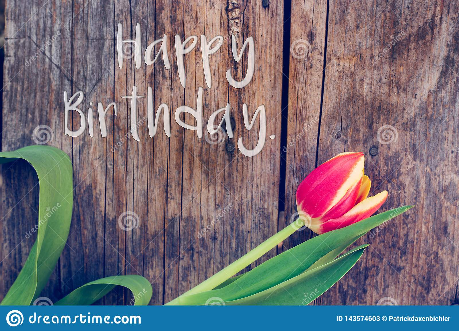 "Happy Birthday: Arrangement of colorful tulips on a rustic wooden table, ""Happy Birthday"