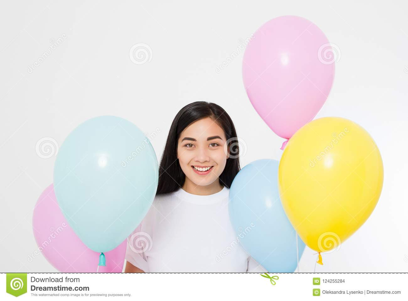 Happy birthday. Balloon party. Happy asian girl with balloons isolated on white background. Copy space.