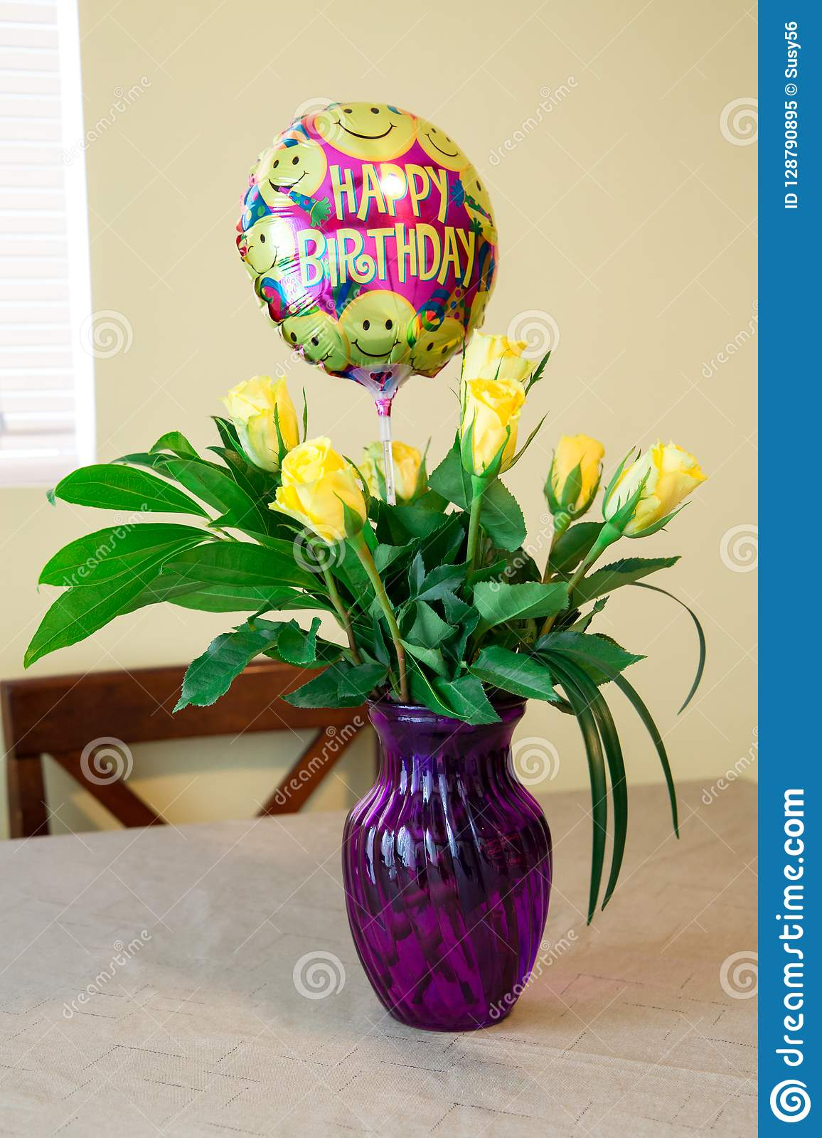 Birthday Bunch Of Yellow Roses In A Purple Vase Front Window