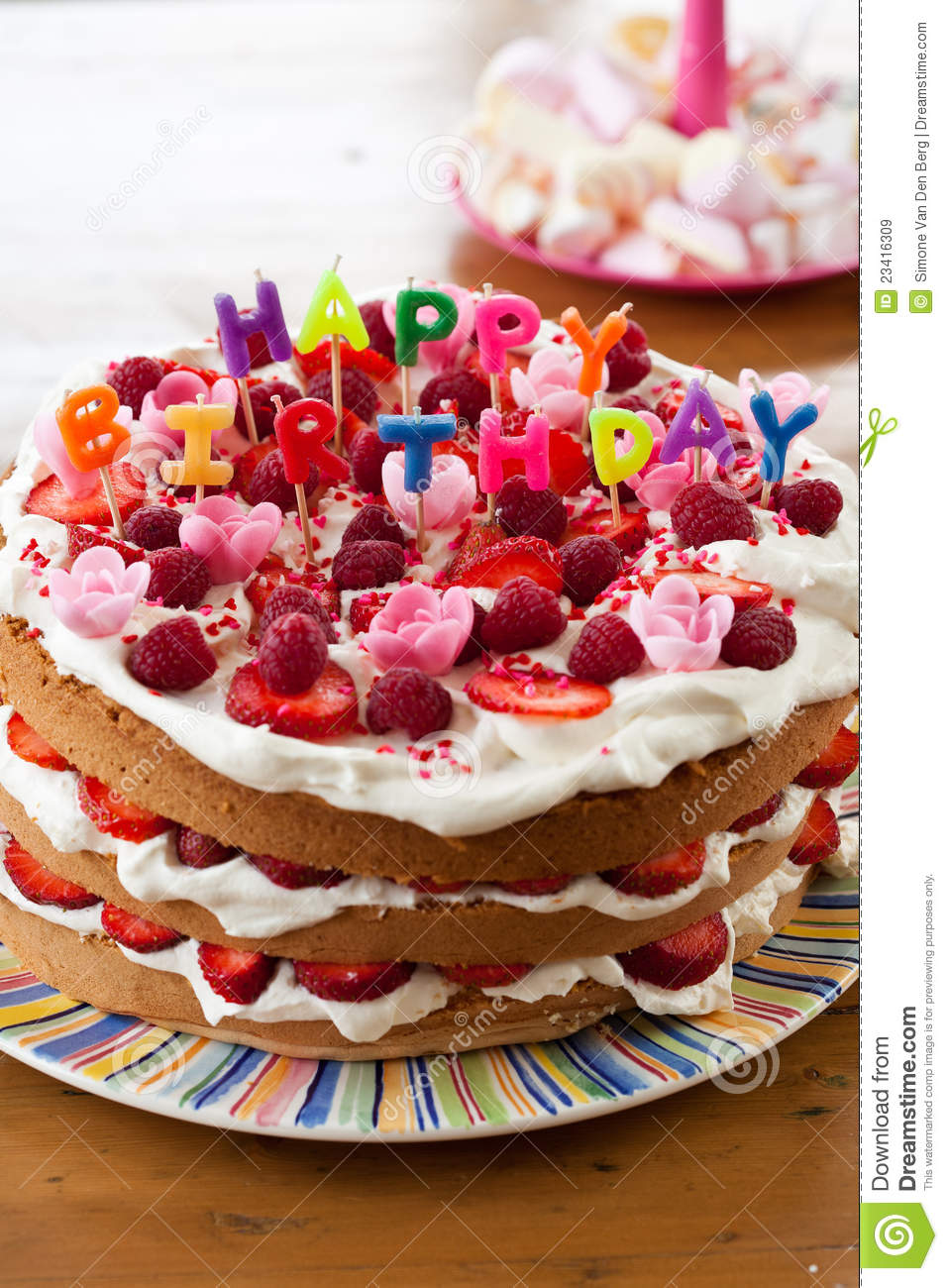 Delicious Cake With Candy Letters On Top That Read Happy Birthday