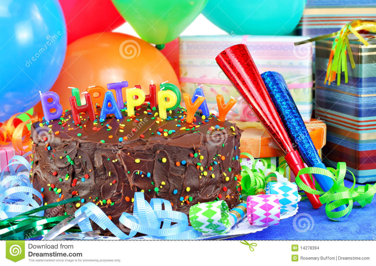 Happy Birthday Candles On Top Of A Chocolate Cake Colorful Balloons Party Horns And Gifts Surround The Pretty