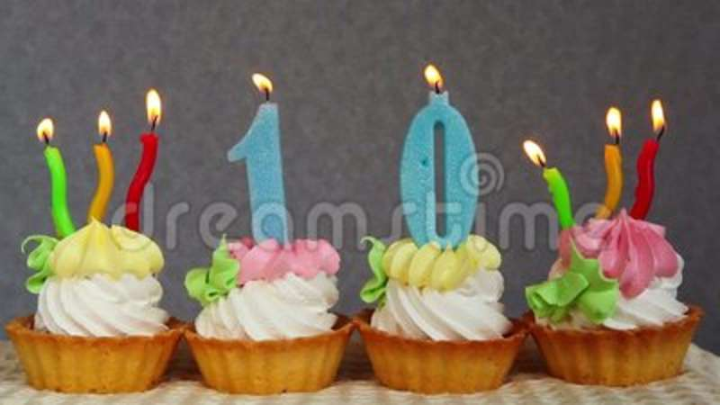 Happy 10 Birthday Cakes And Blue Candles Stock Footage