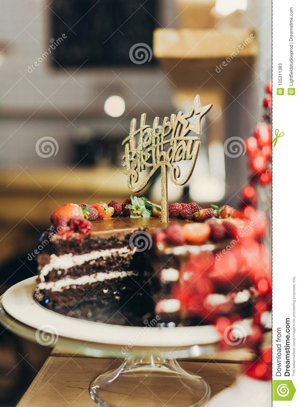 Chocolate Cake With Happy Birthday Sign On Stand