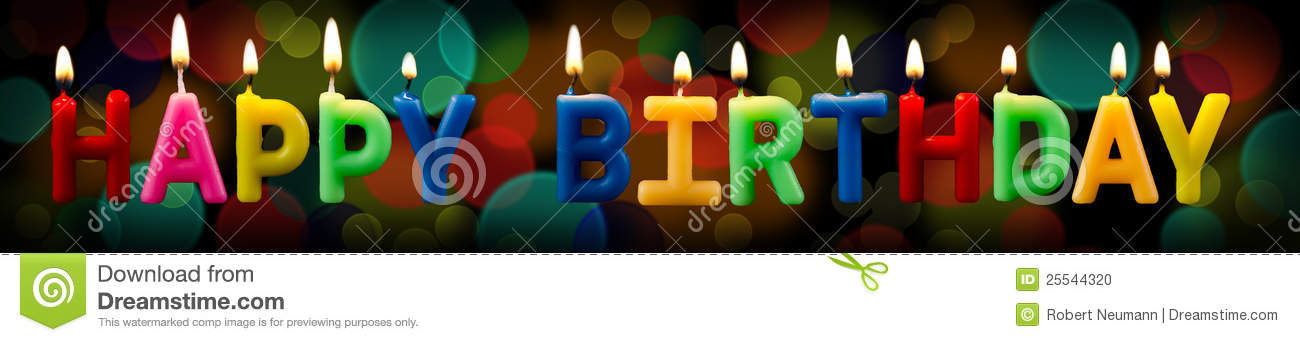 Happy Birthday As A Logo With Candles Before Black Background Bokeh