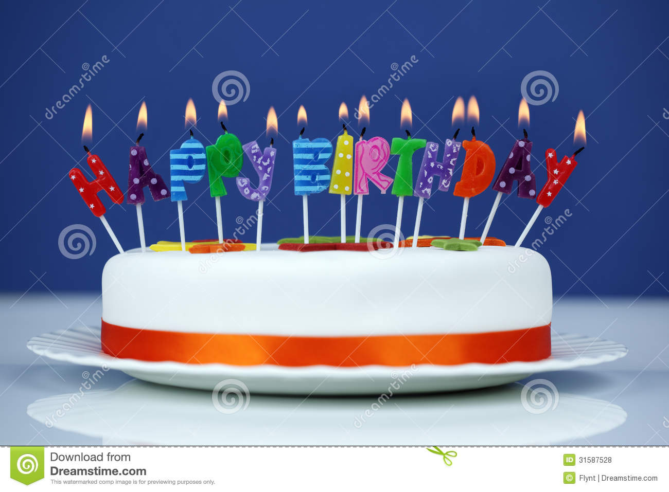 Happy Birthday Candles On A Cake Stock Photo
