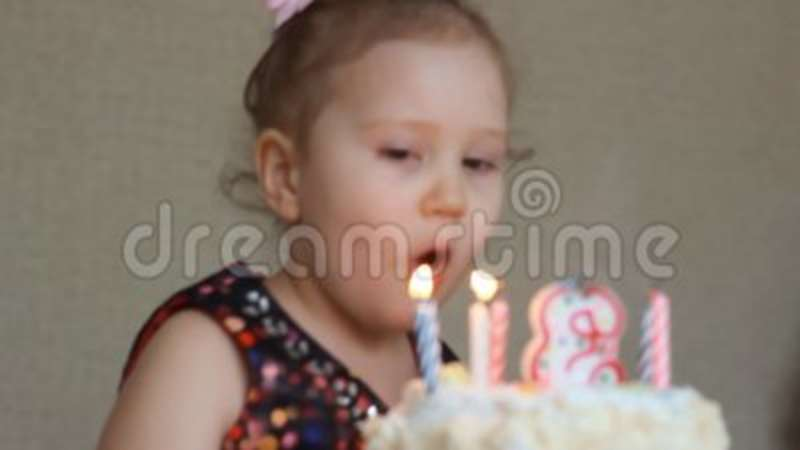 Happy Birthday Cute Child Make A Wish And Blows Out Candles On Cake At Party Funny Little Girl The