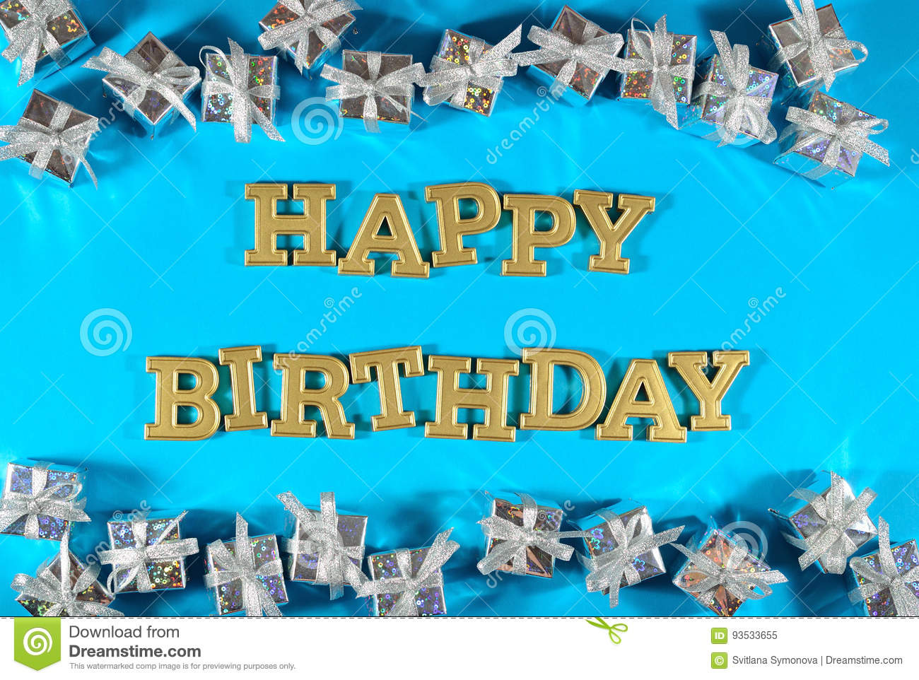 Happy birthday golden text and silver gifts on a blue