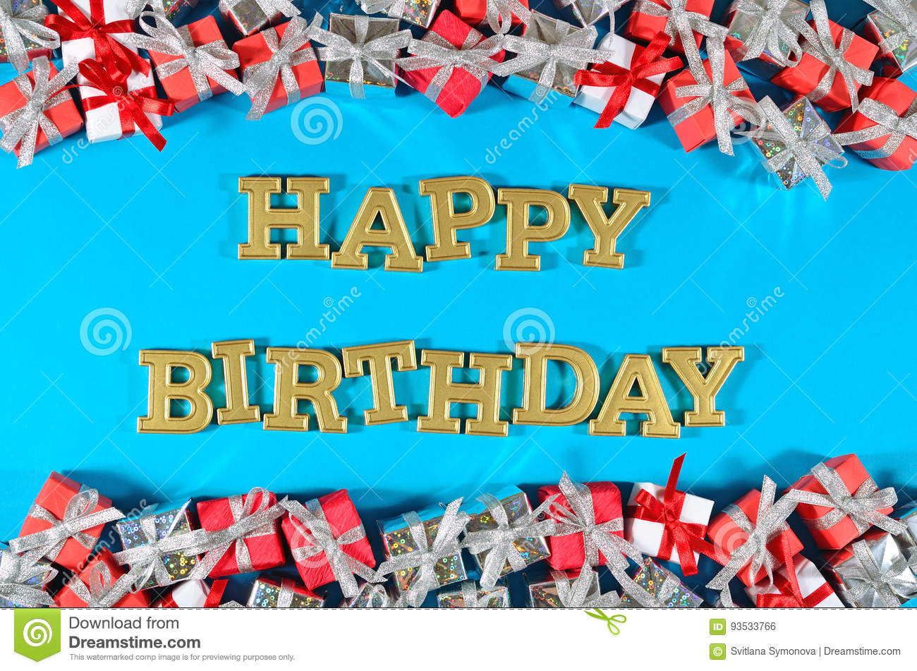 Happy birthday golden text and silver and red gifts on a blue