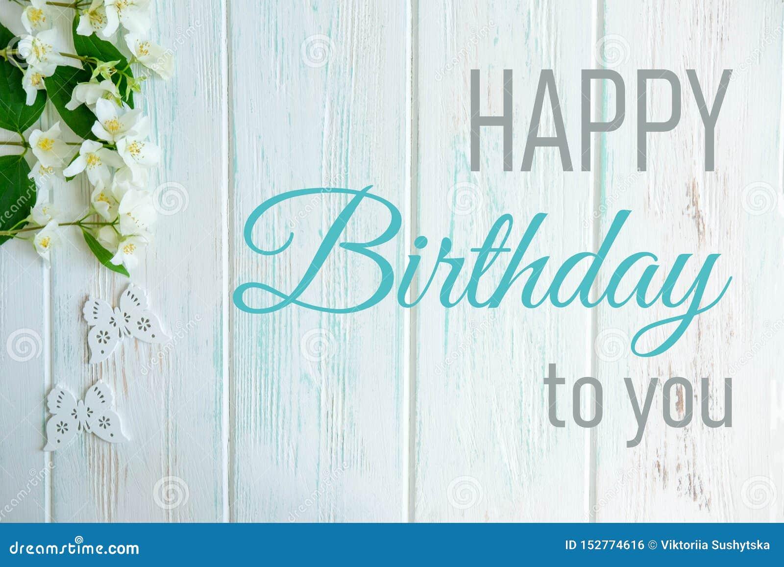 Happy Birthday Greeting Card With Jasmine Flowers On A Light