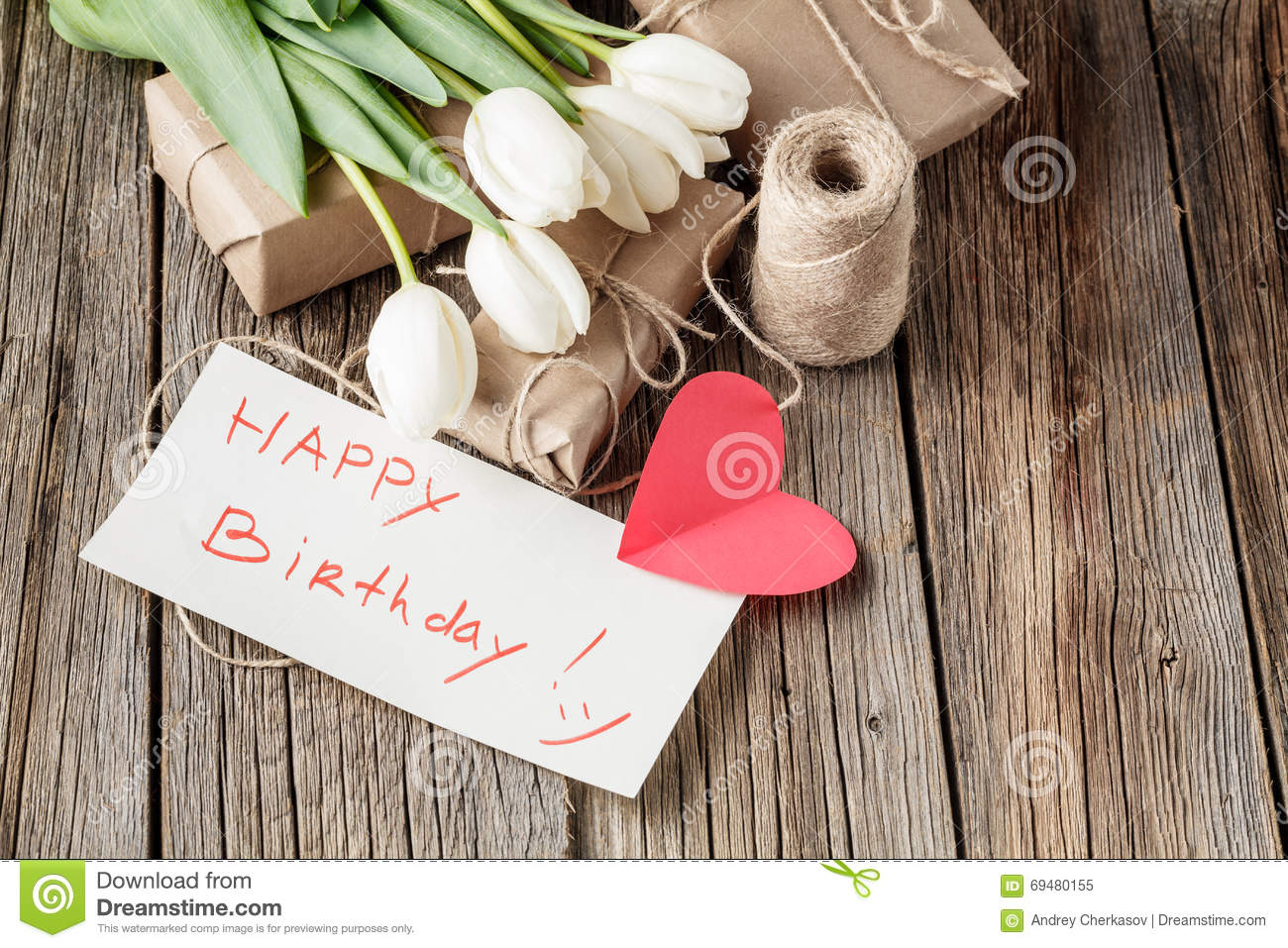 Happy Birthday Mesage With Flowers On Rustic Table