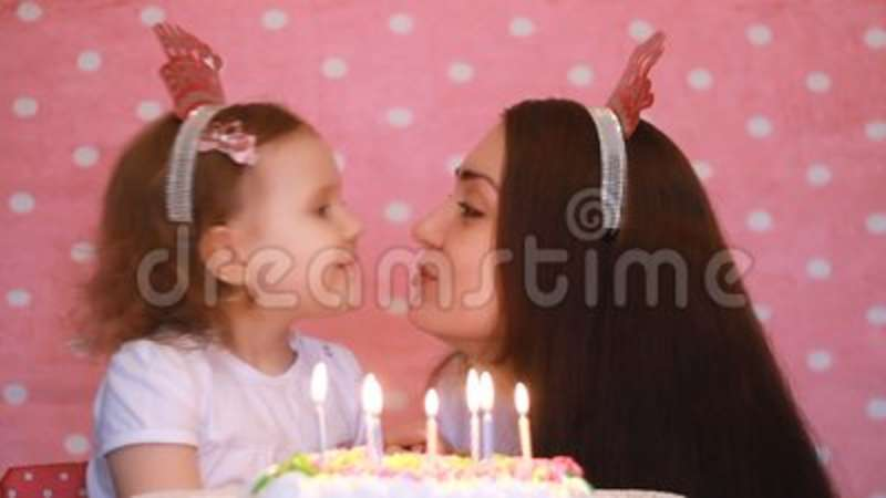 Happy Birthday Mother And Child Make A Wish And Blows Out Candles