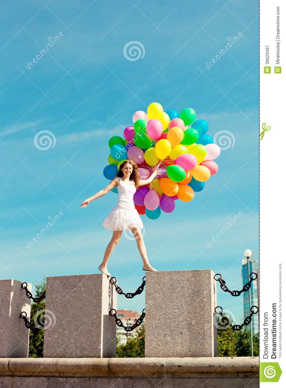 Happy Birthday Woman Against The Sky With Rainbow Colored Air Balloons In Her Hands Sunny And Positive Energy Of Urban Street Young Beautiful Girl On