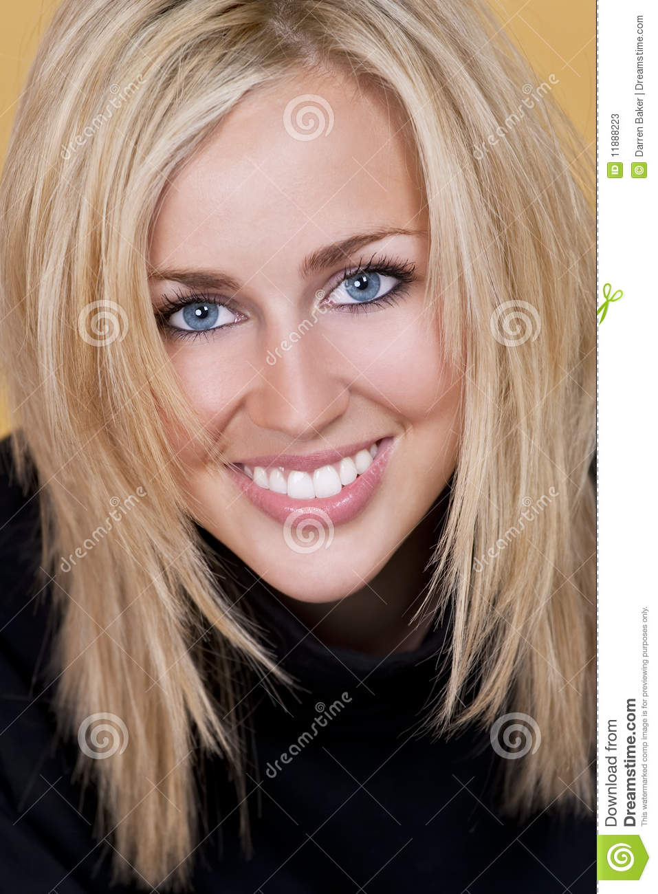 Happy Blond Woman With Perfect Teeth and Smile