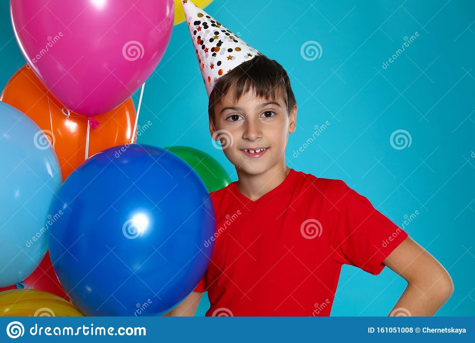 Happy boy with balloons. Birthday celebration